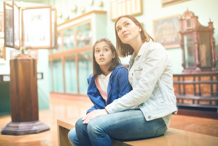 Photo pour Young mother and daughter enjoying medieval expositions in museum. Focus on child - image libre de droit