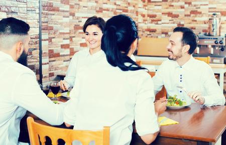 Foto für Group of people dining out merrily in restaurant - Lizenzfreies Bild