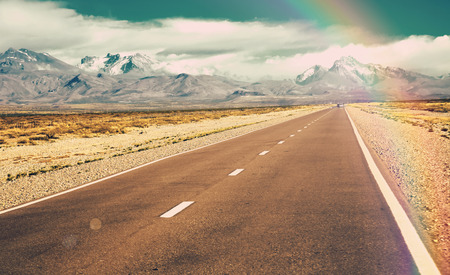 Highway leading to mountains of Andes, near Las Lenas. Argentina, South America