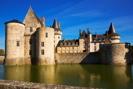 View of medieval castle of Chateau de Sully-sur-Loire in sunny autumn day, France