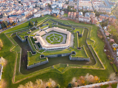 Aerial view of famous Citadel of Jaca on background of cityscape in sunny autumn day, Spain