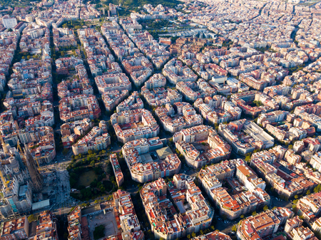 Foto de Panoramic view from drone of Eixample district with Sagrada Familia in Barcelona at sunny day, Spain - Imagen libre de derechos