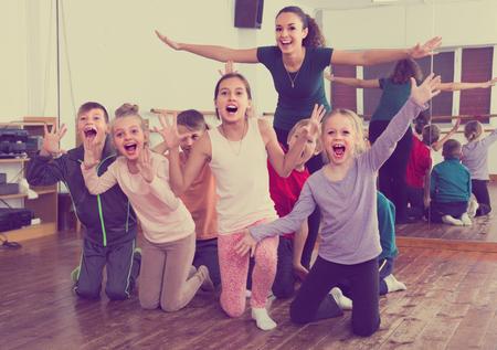 Photo pour Active  emotional children  posing at dance  class  together - image libre de droit