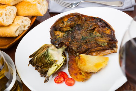 Spanish dish - lamb head with artichoke, tomatoes and potatoes