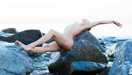 portrait of relaxation  young nude female at  sunset sea shore