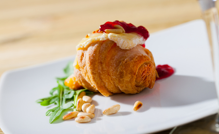 Photo for Tasty dessert – Camembert on top of mini croissant served with raspberry jam - Royalty Free Image