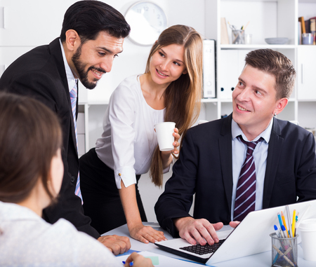 Foto de Business people developing strategy for teamwork in modern office with laptop - Imagen libre de derechos