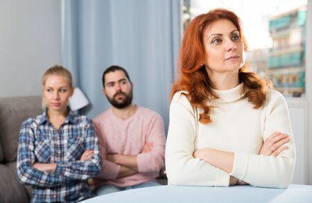 Foto de Young serious couple has a family stressful conversation at home - Imagen libre de derechos