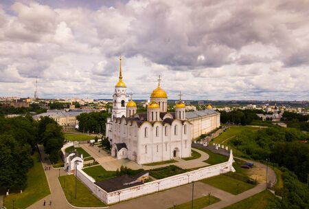 View of Dormition Cathedral on background with Vladimir cityscape in sunny summer day, Russia
