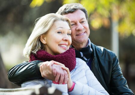 Photo for Portrait of happy senior couple spending time outdoors and enjoying together - Royalty Free Image