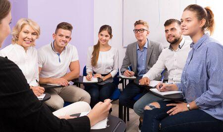 Foto de Portrait of group of students listening teacher in classroom - Imagen libre de derechos