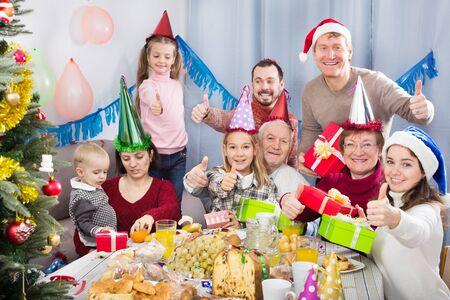 Foto de Large friendly family happy to see each other during a Christmas dinner - Imagen libre de derechos