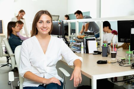 Photo for Portrait of young  cheerful positive smiling female freelancer confidently smiling at workplace in coworking space - Royalty Free Image