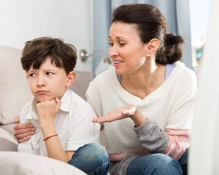 Photo for Loving mother consoling sad preteen son after home disagreements - Royalty Free Image