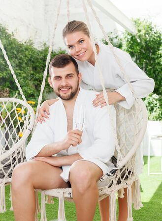 Photo pour attractive happy adult couple relaxing in spa hotel outdoors - image libre de droit