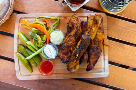 Popular czech grilled pork ribs (Pecena veprova zebra) with three sauces and pickled vegetablesの素材 [FY310134354568]
