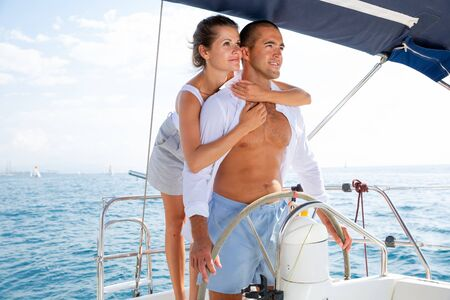Photo for Young man and woman steering pleasure yacht, enjoying romantic sea travel on warm summer day - Royalty Free Image
