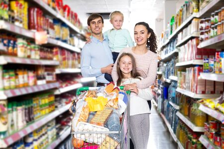 Foto für Friendly family with two daughters shopping in local supermarket - Lizenzfreies Bild