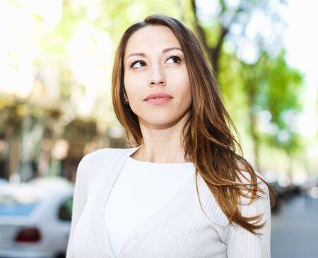 Photo pour Portrait of stylish young woman walking city street in summer day - image libre de droit