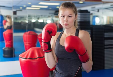 Photo pour Female boxer is kicking in time training in box gym - image libre de droit