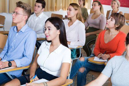 Photo pour Portrait of attentive female student on training session in lecture hall - image libre de droit