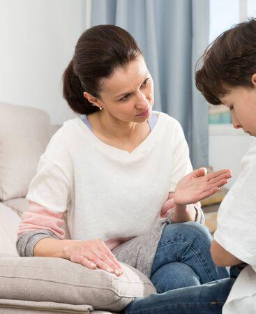 Photo pour Worried mother moralizing preteen son at home. Parenting concept - image libre de droit