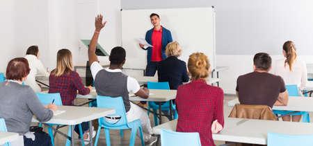 Foto de Male teacher lecturing to students - Imagen libre de derechos