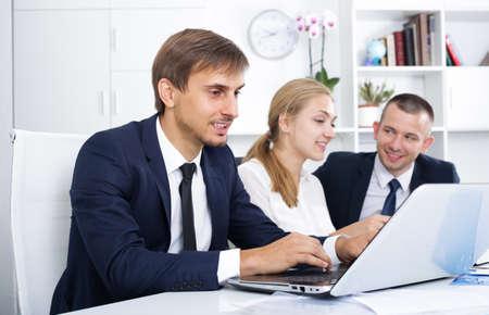 Photo pour three business colleagues in office. - image libre de droit