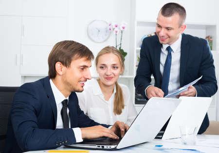 Photo pour business colleagues with laptops in office . - image libre de droit