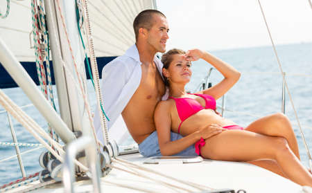 Photo for Woman and man on yacht deck - Royalty Free Image