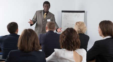 Photo pour Male speaker giving talk in meeting room - image libre de droit