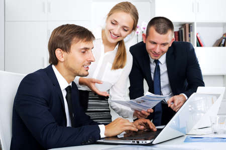 Photo pour Business colleagues with document in hands - image libre de droit