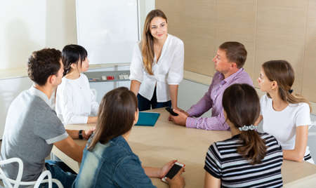 Photo for Woman reading out report to colleagues - Royalty Free Image