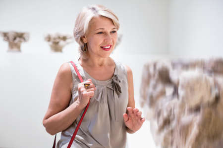 Photo for Adult female looking at artwork sculpture in the museum indoors - Royalty Free Image