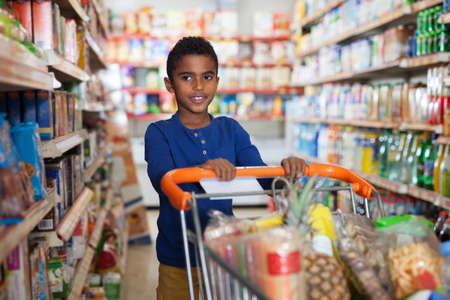 Foto für African boy shopping in grocery - Lizenzfreies Bild