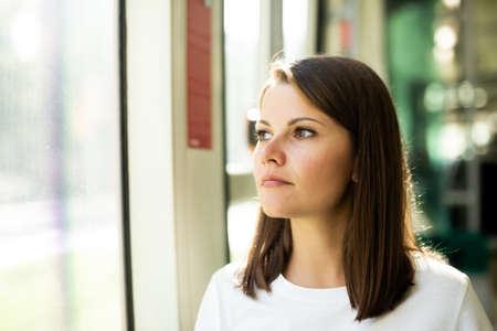 Photo pour Woman traveling in public transport - image libre de droit