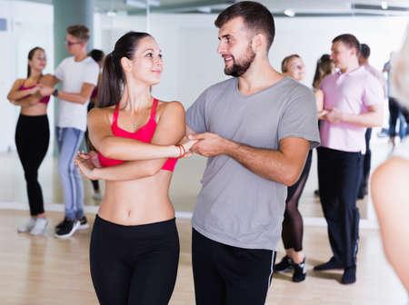 Photo pour Active dancing pair dance tango together - image libre de droit