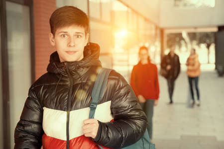 Photo for Teen boy walking to college campus - Royalty Free Image