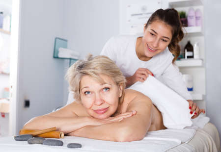 Photo for Mature woman having massage - Royalty Free Image