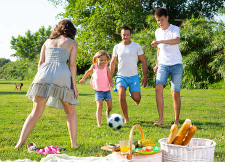Photo pour Cheerful family playing with ball - image libre de droit