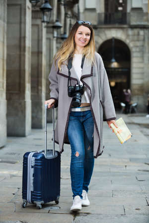 Photo for Girl taking a walk with the travel bag - Royalty Free Image