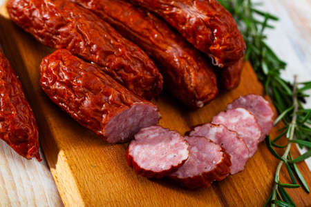 Photo for Roasted chezh sausages susena on cutting board - Royalty Free Image