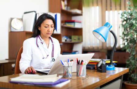 Photo for Doctor working on laptop in medical office - Royalty Free Image