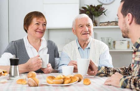 Photo pour Grandparents and grandson breakfast - image libre de droit