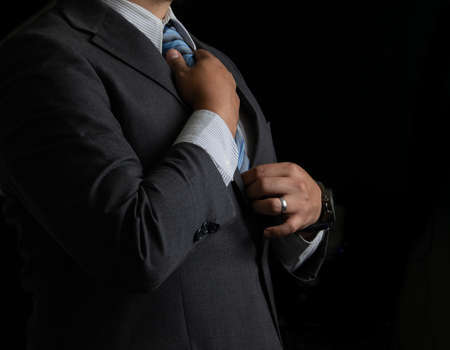 Photo for Successful businessman on black background, smoking and tie - Royalty Free Image