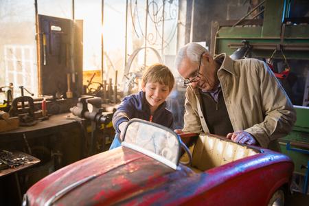 Photo pour A grandfather and his grandson in the DIY workshop - image libre de droit