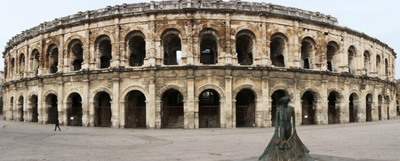 Sunny arches of the ancient Arena of Nimes, Languedoc Roussillon, France