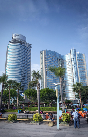 Photo for riverside pdestrian promenade park and skyscrapers in downtown xiamen city china - Royalty Free Image