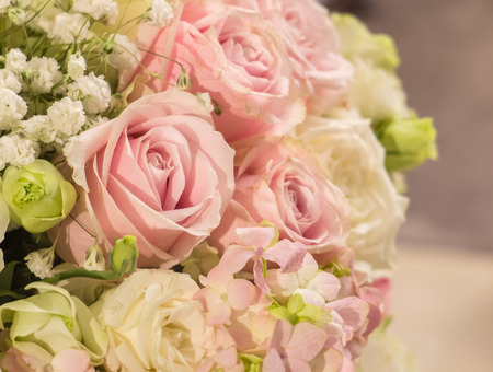 Photo pour Beautiful Pastel Pink Rose at The Corner of The Big Bouquet of Flowers in The Vase for Interior, Selective Focus with Copy Space to input Text - image libre de droit