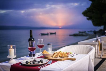 Romantic sunset dinner  on beach